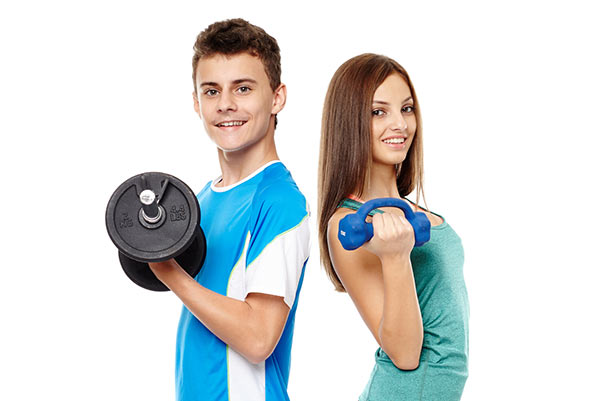 Teenagers exercising with weights